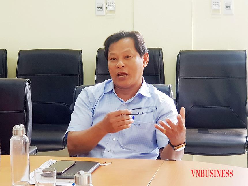 Ông Nguyễn Đức, Giám đốc HTX chợ Hòa Cường trao đổi với phóng viên VnBusiness