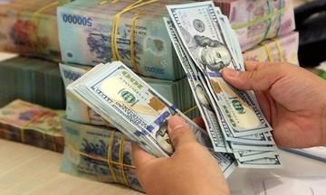 Thị trường tiền tệ ngày 28/4: Giá vàng thế giới giảm, đồng USD phục hồi