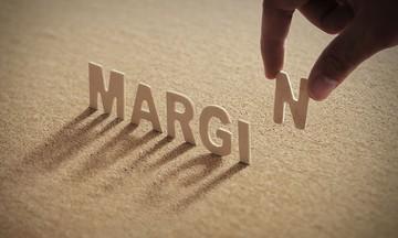 Điều gì xảy ra khi margin gần chạm trần?