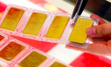 Giá vàng giảm, tỷ giá USD ổn định