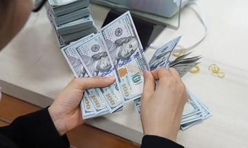 Giá vàng và đồng USD ổn định trong phiên cuối tuần